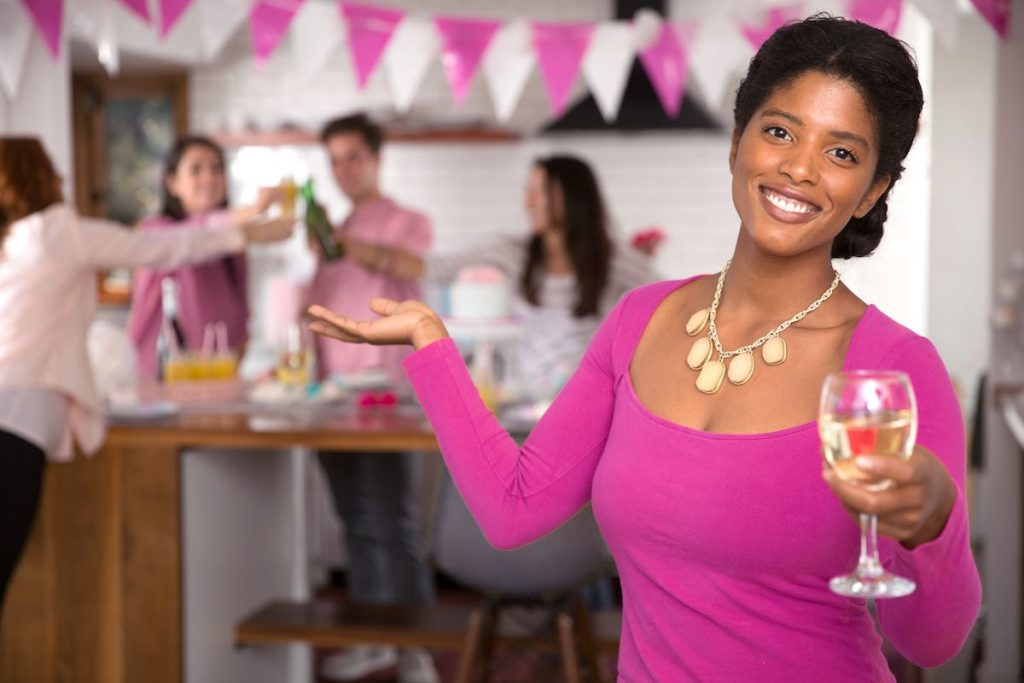 Smiling lady in pink inviting people to the paid social party